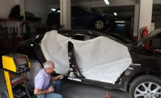 Mazda golpes lateral-reparcion